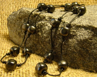 Shungite necklace of squares on a string of Karelia.