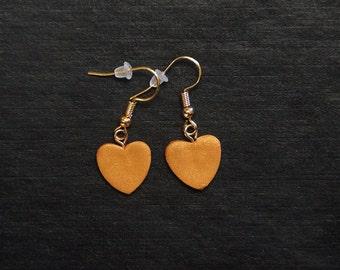Polymer clay dangle heart earrings.