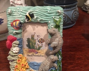 Undersea manatee picture frame brand new so adorable.