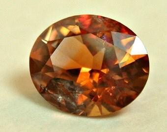 VINTAGE MONTANA Rock Creek SAPPHIRE Orange Faceted oval 0.85 cts src19