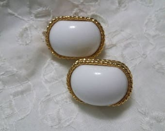 Trifari white and gold clip on earrings