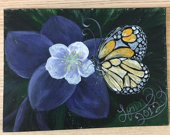 Colorado columbine and monarch butterfly