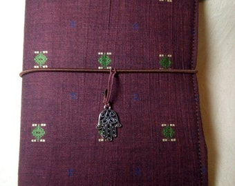 Small notebook cover. With geometric embroidery