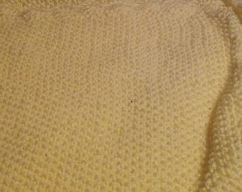 Yellow knit baby blanket