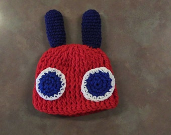 Crochet hat with bug eyes and antenna