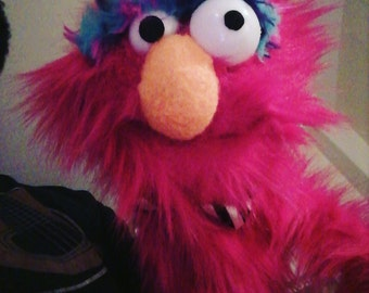 Electric pink fuzzy monster hand puppet