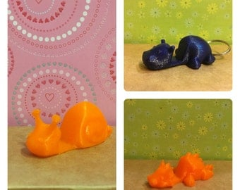 Keychain or cellphone or animal shaped business card holders made with 3D printing in PLA
