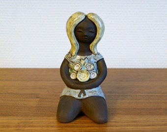 Ceramic Girl with Flowers in Her Hands. Designed by Karl Erik (Ke) Iwar, 1950s/1960s, Sweden, Scandinavia. Figurine.