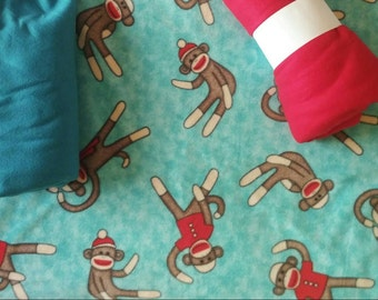 Zippered fleece dog jacket - turquoise sock monkeys