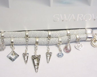 Bracelet handmade with Swarovski crystals, sterling silver, and other metals, and rope climbing. Single, didinastie.