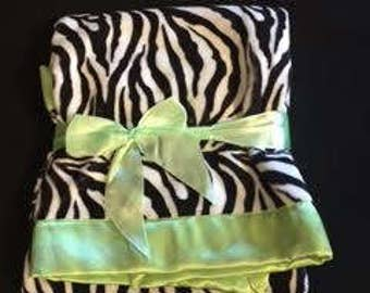 Zebra print Minky baby blanket with mint green satin trim