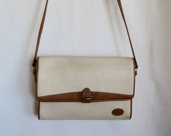 sale Pebbled leather cross body bag in off white and tan on a slender leather strap. By Liz Claiborne.
