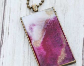 Pink and gold are bold in this rectangle resin pendant