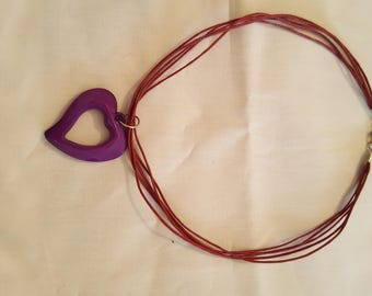 Fine cords and purple plastic necklace heart