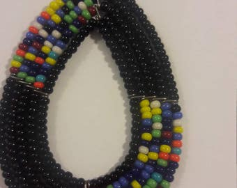 oval handcrafted black and multi-colored pattern