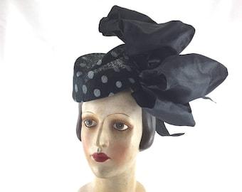 Polka dot perching hat with big black taffeta bow