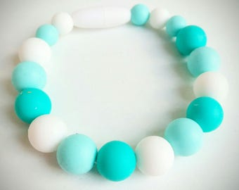 Bracelet of portage and breastfeeding silicone turquoise and white
