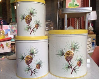 Midcentury kitchen three canister set vintage pinecones white and yellow
