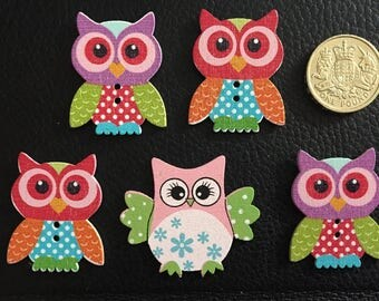 5 brightly coloured wooden owls