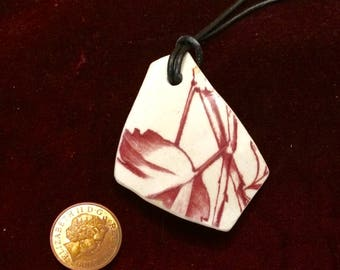 Unique vintage Thames foreshore red/white pottery shard pendant