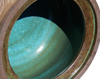 """Black stoneware pot carved beetle, lotus design and """"EARTH"""" lettring, turquoise glaze inside"""