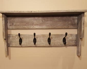 Rustic shelf with hooks.