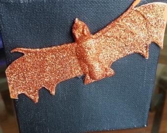 Orange Glitter Bat on Black Canvas