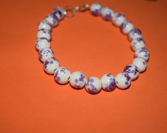 Purple and white beaded bracelet