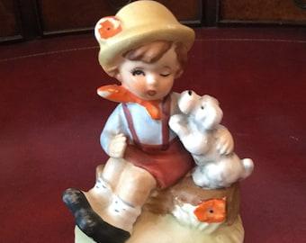 Vintage boy with dog figurine