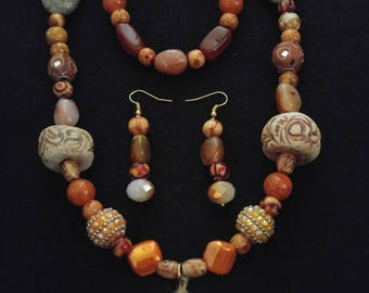 Shell pendant and ceramic beaded necklace set.