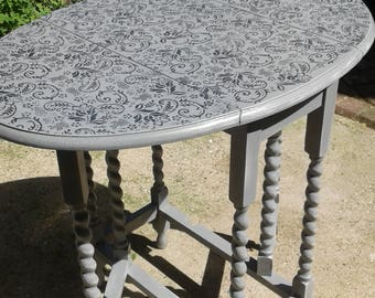 Upcycled folding oval dining table