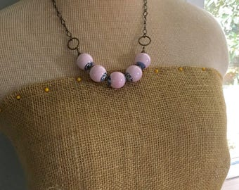 Pink, white, and blue vintage tin necklace