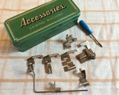 Vintage Sewing Machine Accessories tin, with low shank accessories, quilting guide, edgesticher, binder, hemmers and screwdriver.