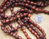 108 carved wood mala 9x10mm skull beads
