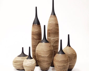 Made To Order - set of 7 large ceramic stoneware bottle vases glazed in an earthy textural tan/ off white crater glaze by sarapaloma