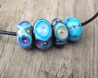 Small Set Of Pretty Handmade Glass Beads In Purple and Blue Artisan Handmade For Jewelry Design