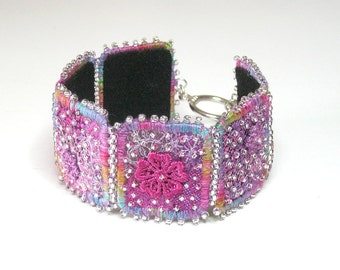 """FABRIC BRACELET: """"Inchworm"""" Art piece lavishly embroidered with applique and beads.  Medium. Handmade by Procione."""