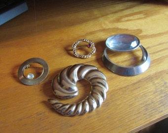 4 circle brooches