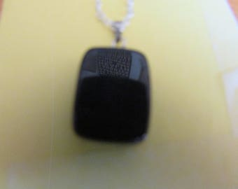polished obsidian stone pendent
