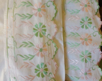 two vintage embroidered green and pink scalloped pillow cases