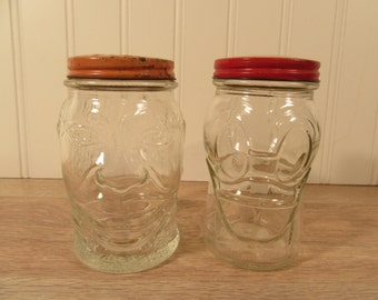 2 Lucky Joe glass banks with metal screw on lid- funny face and duck face designs- both for one price- fine condition