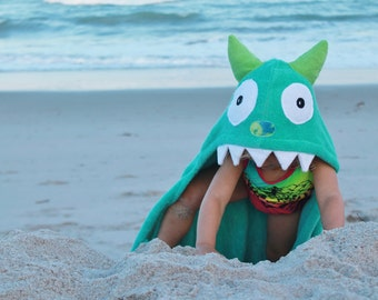 Yikes Twins Turquoise Monster Hooded towel