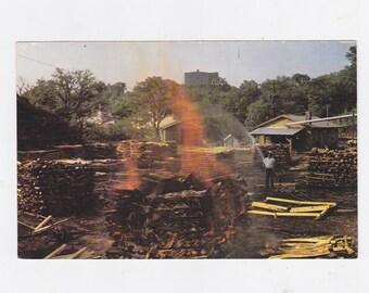 Vintage post card making charcoal at jack Daniel's distillery Lynchburg Tennessee