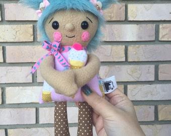 Little Hugs Fleece Dolls. Ice cream print plushie. Plush toy holding coordinating mini pillow. Blue faux fur hair. Velcro hands. Polka dots