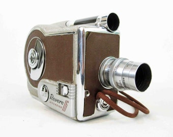 Vintage Revere Model 16 Magazine Movie Camera. Circa 1940's. Includes Original Box and Instructions.