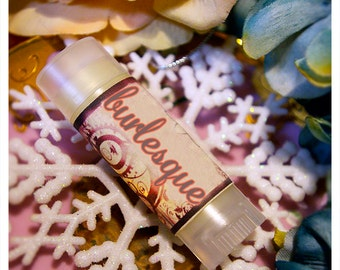 burlesque - rich mexican vanilla flavored lip embellishment- housed in nifty frosted dispenser