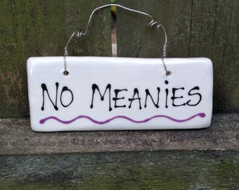 No meanies hanging sign.