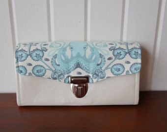 Necessary Clutch Wallet in Octogarden in Aqua with pearl/ivory vinyl