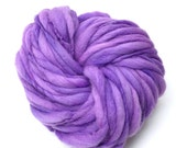 Super bulky handspun yarn, 48 yards and 2.85 ounces/ 81 grams, spun thick and thin in purple merino wool
