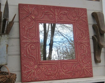 Vintage tin tile mirror. 2'x2' mirror.  Antique architectural salvage ceiling tin tiles. Red wall mirror. Embossed tin.